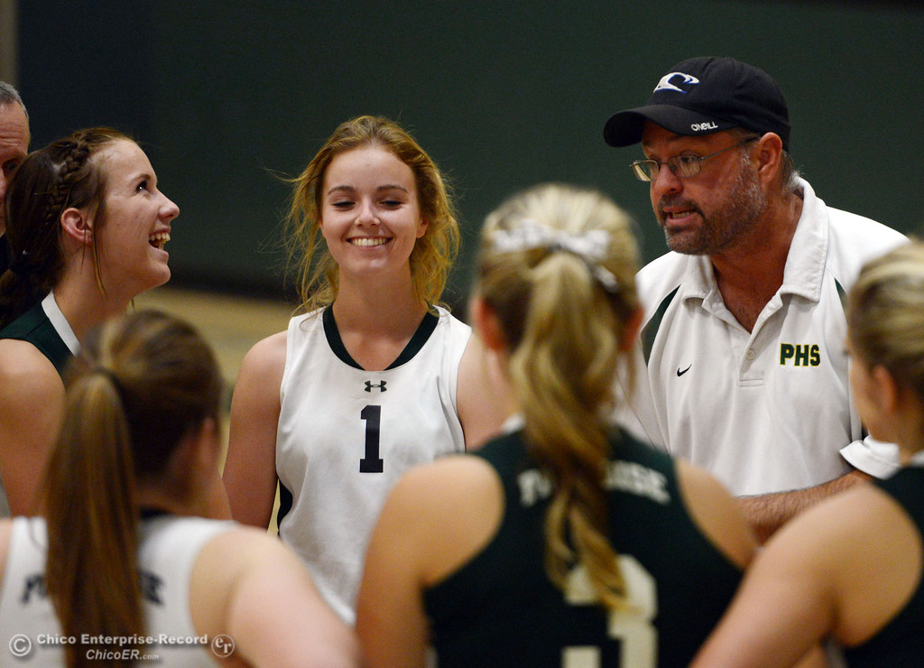 . Paradise High\'s coach John Parks (center) talks to his team in a timeout against Chico HIgh in the second game of their girls volleyball match at PHS Thursday, October 10, 2013 in Paradise, Calif.  (Jason Halley/Chico Enterprise-Record)