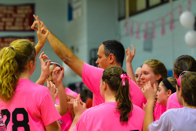 North Middlesex volleyball head coach Mark Roy celebrates with his team after Wednesday night's 3-0 win over Hudson.         Nashoba Publishing/Ed Niser