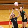 SAM HOUSEHOLDER | THE GOSHEN NEWS<br /> Wawasee senior Alli Ousley sets the ball during the match against Goshen Thursday at Goshen High School.