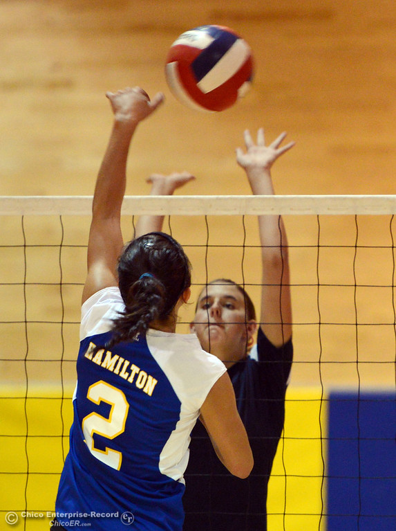 . Hamilton High\'s #2 Raegan Avrit (left) spikes against Gridley High\'s #15 Kaelin Rice (right) in their second game of their volleyball match Thursday, August 29, 2013 in Chico, Calif.  (Jason Halley/Chico Enterprise-Record)