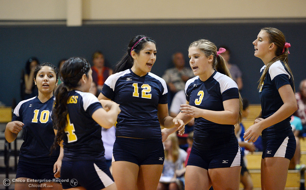 . Gridley High\'s #10 Alejandra Caudillo, #4 Vanessa Ramirez, #12 Lauren Solis, #3 Megan Anthony and #15 Kaelin Rice (left to right) ready against Hamilton High in their first game of their volleyball match Thursday, August 29, 2013 in Chico, Calif.  (Jason Halley/Chico Enterprise-Record)