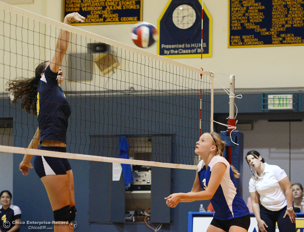. Hamilton High\'s #3 Kendra Gordon (right) watches against Gridley High\'s #20 Haylee Coats (left) who spikes the ball in their second game of their volleyball match Thursday, August 29, 2013 in Chico, Calif.  (Jason Halley/Chico Enterprise-Record)