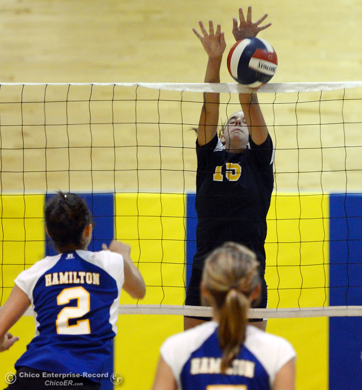 . Gridley High\'s #15 Kaelin Rice (center) blocks against Hamilton High\'s #2 Raegan Avrit (left) in their second game of their volleyball match Thursday, August 29, 2013 in Chico, Calif.  (Jason Halley/Chico Enterprise-Record)