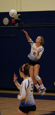 Exeter Monarch Jacque Hutcheson lets a serve fly against Kingburg on Thursday, October 17, 2013.