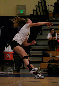 Kingsburg volleyball player putting everything into her serve.