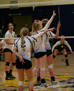 Exeter setter Jacque Hutcheson signals the play against Kingsburg on Thursday, October 17, 2013.
