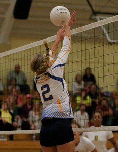 Exeter High School setter Jacque Hutcheson attempts a block at the net.