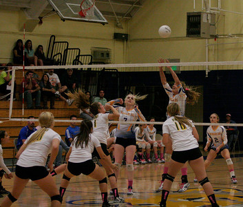 Monarch Olivia Harden (9) goes up for a block against Kingsburg as Monarch Chelsea Larson (7)  looks on.