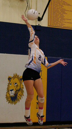 Exeter Monarch Jacques Hutcheson lets a serve fly against Kingsburg on October 17, 2013.
