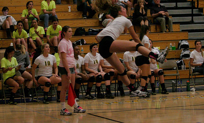 Kingsburg Viking Becca Davis (1) lets a serve fly against Exeter on October 17, 2013.