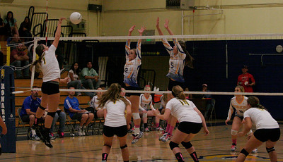 Monarch volleyball players Jacque Hutcheson (2) and Gabi Crookshanks (5) blocking a spike against Kingsburg on October 17, 2013.