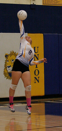 Exeter Monarch McKinley Kavadas (8) lets a serve fly against Kingsburg in Exeter on Thursday, October 17, 2013.