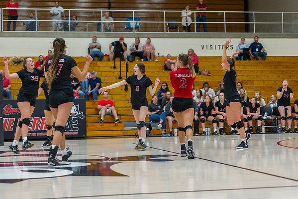 And with that point, the Lady Berries celebrate their victory in four sets over the Lady Redskins on Wednesday night at the Berry Bowl. Fran Ruchalski | Pharos-Tribune