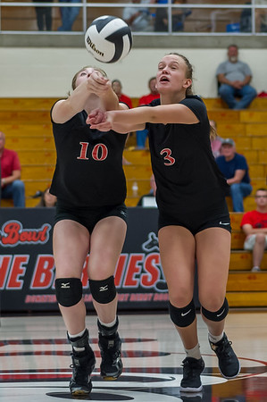 Logansport sophomores Carley Camp (10) and Mayce McClure (3) both go after  the ball at the same time as the Lady Berries defeated the Lady Redskins of Knox in four sets on Wednesday night. Fran Ruchalski | Pharos-Tribune