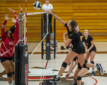 Logansport senior Allie McClure (1) smacks the ball over the net as the Lady Berries defeated the Lady Redskins of Knox in four sets on Wednesday night. Fran Ruchalski | Pharos-Tribune