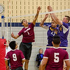 Fitchburg High's Gerald Baez goes up at the net against Monty Tech's Josh Gamache and Kurt Swenson during the match against on Tuesday afternoon. SENTINEL & ENTERPRISE / Ashley Green