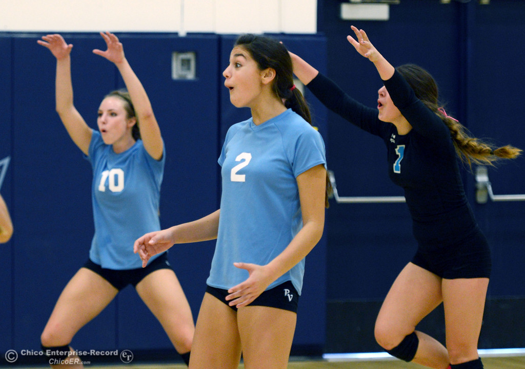 . Pleasant Valley High\'s #10 Ashley Geiger, #2 Lily Justine, and #1 Brooke Fogel (left to right) react to a score against Chico High in the second game of their girls volleyball match at PVHS Varley Gym Saturday, October 12, 2013 in Chico, Calif.  (Jason Halley/Chico Enterprise-Record)