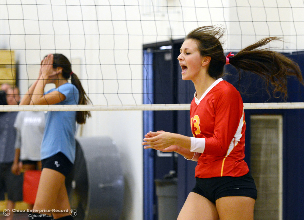 . Pleasant Valley High\'s #2 Lily Justine (left) reacts to Chico High\'s #13 Becca Korte (right) celebrate a score in the first game of their girls volleyball match at PVHS Varley Gym Saturday, October 12, 2013 in Chico, Calif.  (Jason Halley/Chico Enterprise-Record)