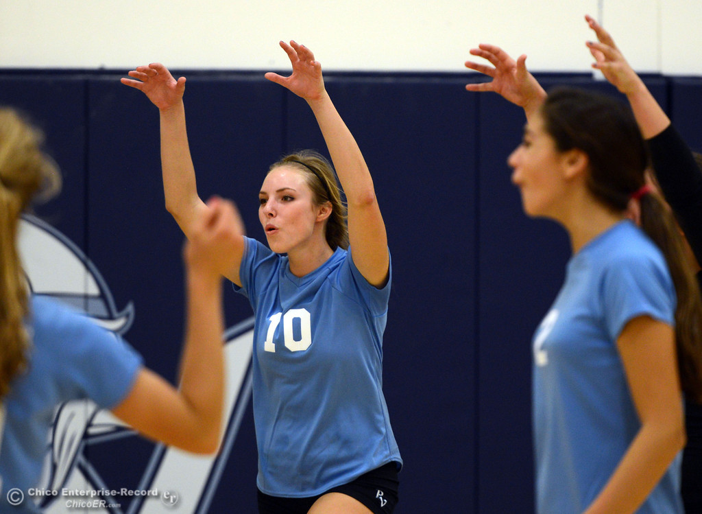 . Pleasant Valley High\'s #10 Ashley Geiger, (center) reacts to a score against Chico High in the second game of their girls volleyball match at PVHS Varley Gym Saturday, October 12, 2013 in Chico, Calif.  (Jason Halley/Chico Enterprise-Record)