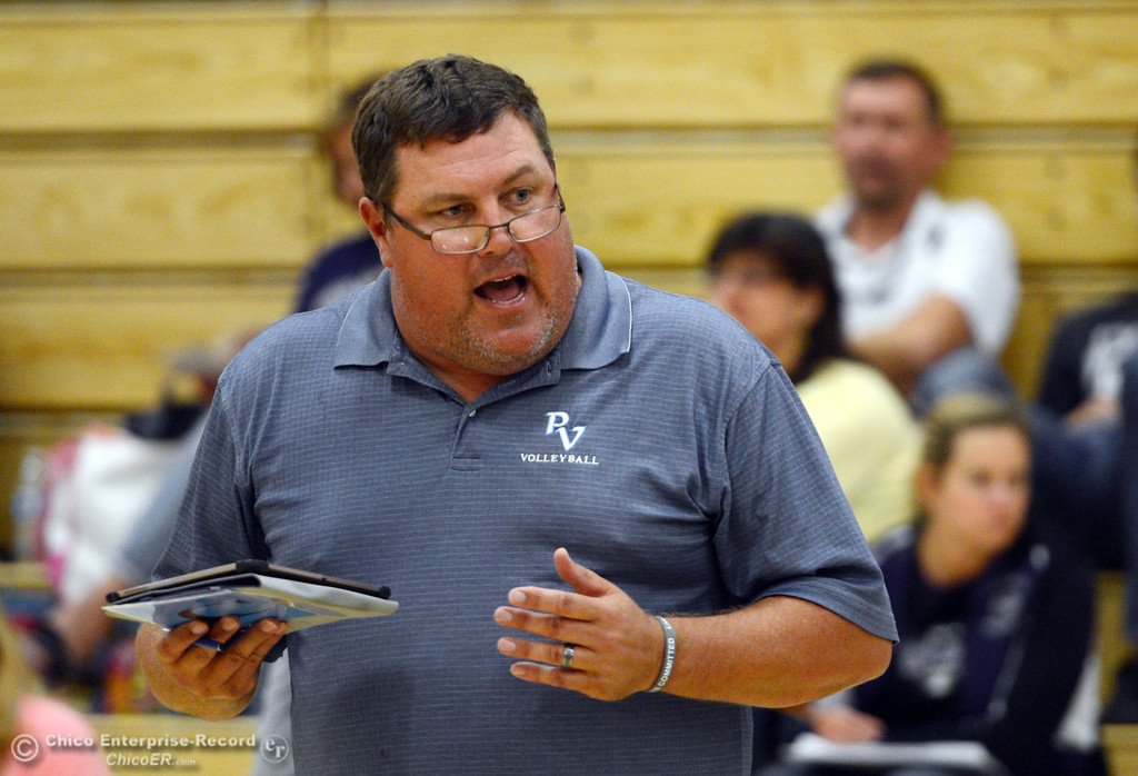 . Pleasant Valley High coach John Mitchell against Chico High in the second game of their girls volleyball match at PVHS Varley Gym Saturday, October 12, 2013 in Chico, Calif.  (Jason Halley/Chico Enterprise-Record)