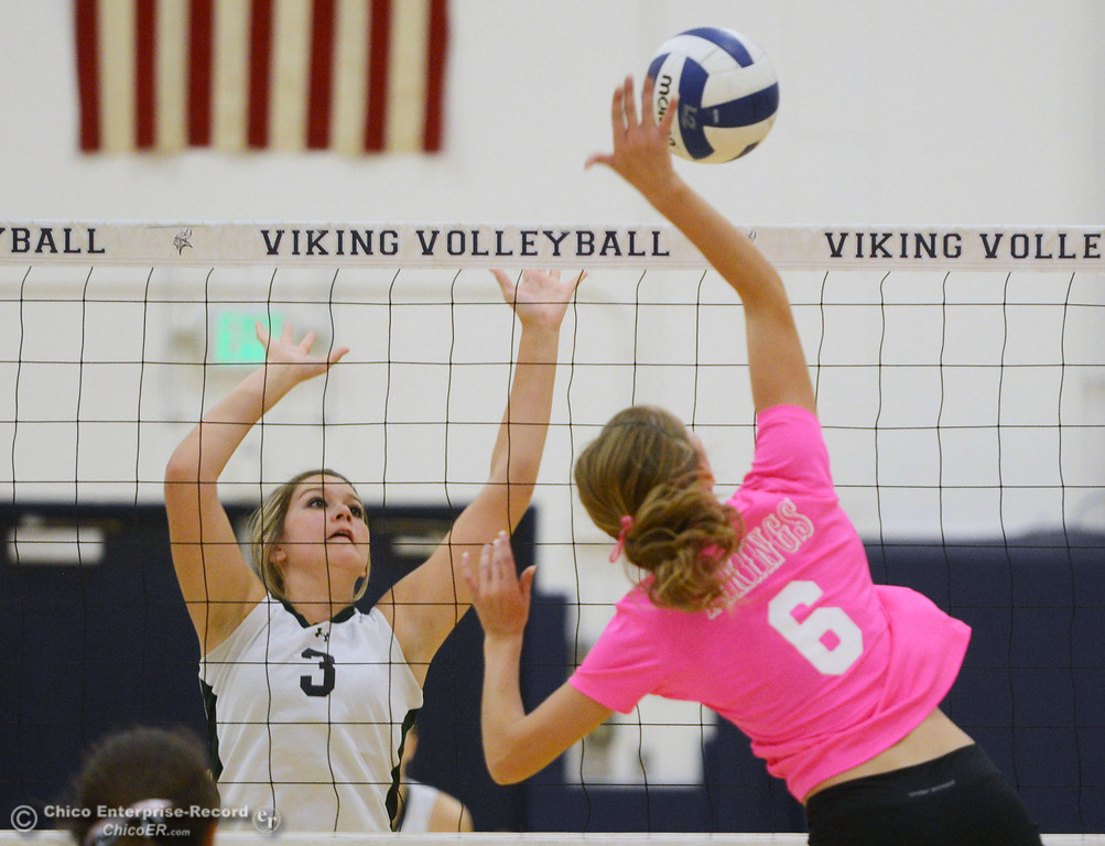 ". Pleasant Valley High\'s #6 Hanne Henriksen (right) spikes against Paradise High\'s #3 Kelsi Earhart (left) in the first game of their volleyball match at PVHS Varley Gym Thursday, October 17, 2013 in Chico, Calif. PV volleyball wore pink instead of blue vs Paradise at ""Fight Like a Viking Night,\"" to raise money for cancer research. (Jason Halley/Chico Enterprise-Record)"