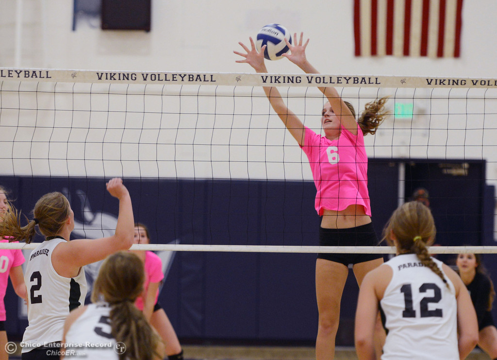 ". Pleasant Valley High\'s #6 Hanne Henriksen misses a block against Paradise High in the second game of their volleyball match at PVHS Varley Gym Thursday, October 17, 2013 in Chico, Calif. PV volleyball wore pink instead of blue vs Paradise at ""Fight Like a Viking Night,\"" to raise money for cancer research. (Jason Halley/Chico Enterprise-Record)"