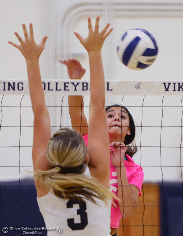 ". Pleasant Valley High\'s #2 Lily Justine (right) spikes against Paradise High\'s #3 Kelsi Earhart (left) in the second game of their volleyball match at PVHS Varley Gym Thursday, October 17, 2013 in Chico, Calif. PV volleyball wore pink instead of blue vs Paradise at ""Fight Like a Viking Night,\"" to raise money for cancer research. (Jason Halley/Chico Enterprise-Record)"