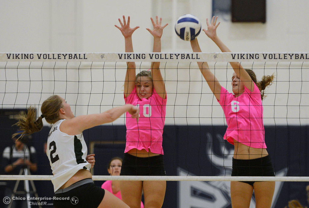 ". Paradise High\'s #2 Bailey Bengson (left) spikes the ball against Pleasant Valley High\'s #10 Ashley Geiger (center) and #6 Hanne Henriksen (right) in the second game of their volleyball match at PVHS Varley Gym Thursday, October 17, 2013 in Chico, Calif. PV volleyball wore pink instead of blue vs Paradise at ""Fight Like a Viking Night,\"" to raise money for cancer research. (Jason Halley/Chico Enterprise-Record)"