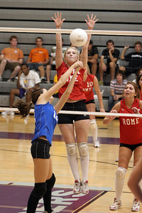 Cass's #12 Sarah Chase tries to hit it past Rome's #17 Jessica Carpenter and #5 Brittney Fricks (right)