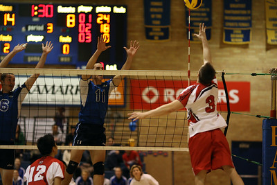 Reid Hall hitting at Greg McDonald (6J0E4435) Greg McDonald goes up on a block attempt against York's Reid Hall (6J0E4435)