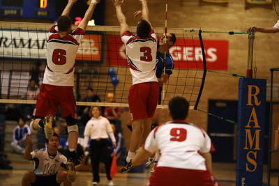 Dimnik and Hall set a block (6J0E4409) Tommy Nguyen (14) at the ready, just in case York's Sean Dimnik (6) or Reid Hall (3) make the block (6J0E4409)