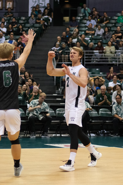 Hawaii's James Anastassiades (2) and Gage Worsley (6) celebrate a point in an opening night match against Charleston at the Stan Sheriff Center in Honolulu, Hawaii on January 3, 2020.