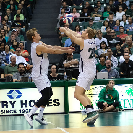 Hawaii setter Jackson Van Eekeren (20) and hitter James Anastassiades (2) both go for the second ball in an opening night match against Charleston at the Stan Sheriff Center in Honolulu, Hawaii on January 3, 2020.