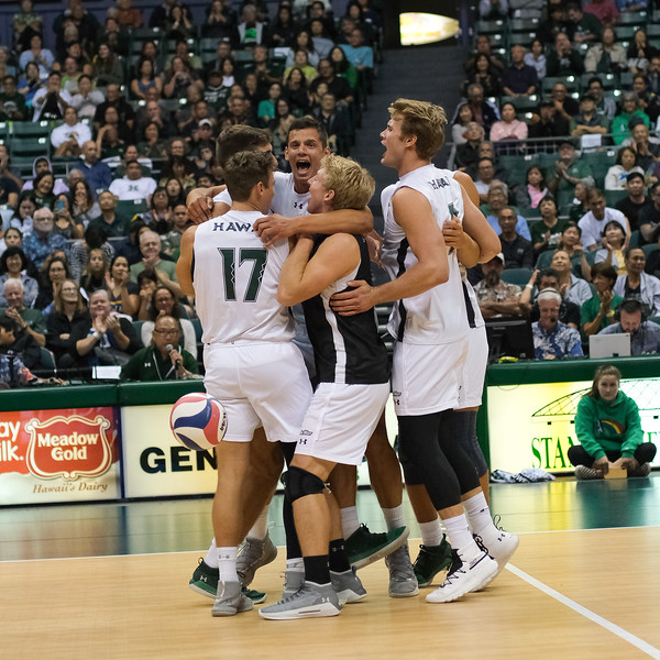 The six players on the floor for Hawaii celebrate winning a point in an opening night match against Charleston at the Stan Sheriff Center in Honolulu, Hawaii on January 3, 2020.