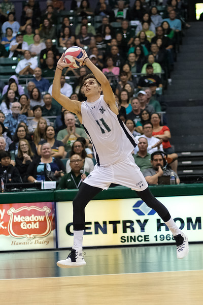 Hawaii's Dimitrios Mouchlias (11) puts the ball over on three in an opening night match against Charleston at the Stan Sheriff Center in Honolulu, Hawaii on January 3, 2020.