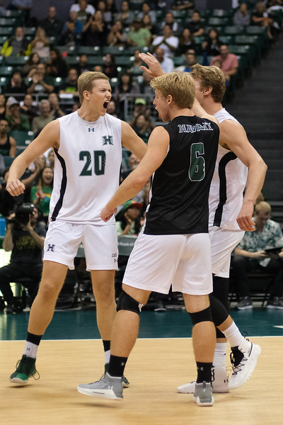Hawaii's Jackson Van Eekeren (20), James Anastassiades (2) and Gage Worsley (6) celebrate in an opening night match against Charleston at the Stan Sheriff Center in Honolulu, Hawaii on January 3, 2020.