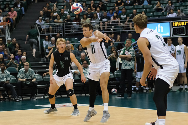 Hawaii outside hitter Colton Cowell (17) receives serve in an opening night match against Charleston at the Stan Sheriff Center in Honolulu, Hawaii on January 3, 2020.