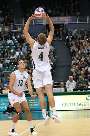 Hawaii's Brett Sheward (4) sets middle blocker Guilherme Voss (12) in an opening night match against Charleston at the Stan Sheriff Center in Honolulu, Hawaii on January 3, 2020. Sheward had 2 assists on the night.
