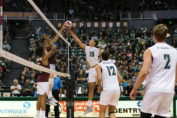 Hawaii's Rado Parapunov (19) jousts at the net in an opening night match against Charleston at the Stan Sheriff Center in Honolulu, Hawaii on January 3, 2020.