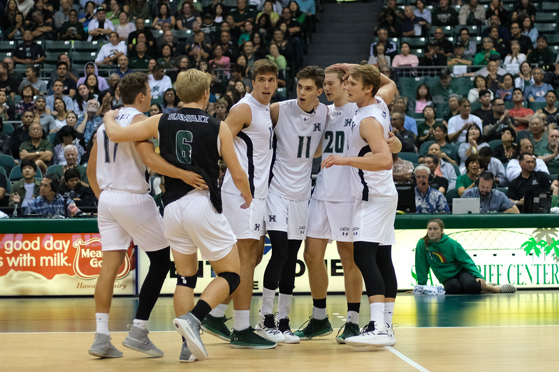 The Hawaii mens volleyball team gathers at the 10 foot line in an opening night match against Charleston at the Stan Sheriff Center in Honolulu, Hawaii on January 3, 2020.