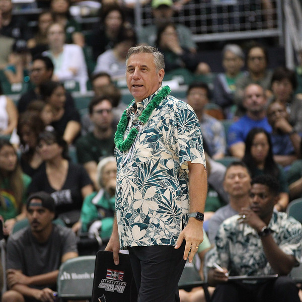 Hawaii head coach Charlie Wade smiles during a break in action in an opening night match against Charleston at the Stan Sheriff Center in Honolulu, Hawaii on January 3, 2020.
