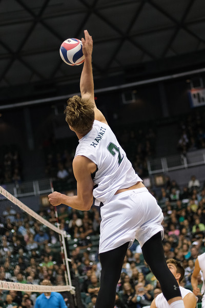 Hawaii hitter James Anastassiades (2) swings from the left side in an opening night match against Charleston at the Stan Sheriff Center in Honolulu, Hawaii on January 3, 2020. Anastassiades had 2 kills but also chipped in 2 service aces.