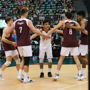 Charleston libero Edgar Sanchez (1) leads a huddle at midcourt in an opening night match against Hawaii at the Stan Sheriff Center in Honolulu, Hawaii on January 3, 2020.