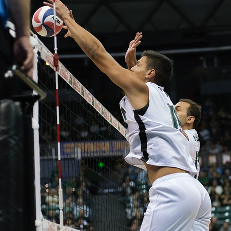 Hawaii oppo Rado Parapunov (19) and middle blocker Guilherme Voss (12) put up a double block in an opening night match against Charleston at the Stan Sheriff Center in Honolulu, Hawaii on January 3, 2020. Hawaii's defense held Charleston to a .246 hitting average.