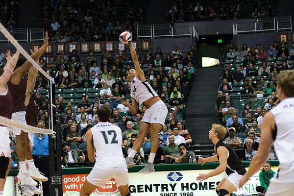 Hawaii's Rado Parapunov (19) hits from the right side in an opening night match against Charleston at the Stan Sheriff Center in Honolulu, Hawaii on January 3, 2020. Parapunov was second for Hawaii with 9 kills.