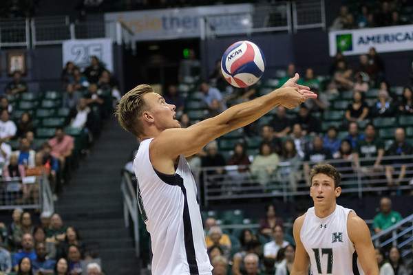 Jakob Thelle (10) of Hawaii sets with his forearms as hitter Colton Cowell (17) looks on in an opening night match against Charleston at the Stan Sheriff Center in Honolulu, Hawaii on January 3, 2020.