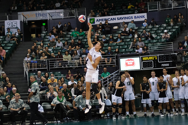 Hawaii freshman Devon Johnson (9) hits a jump serve in the third set of an opening night match against Charleston at the Stan Sheriff Center in Honolulu, Hawaii on January 3, 2020. Johnson, a 6-6 outside hitter from Thousand Oaks, California, had one service error on one attempt.