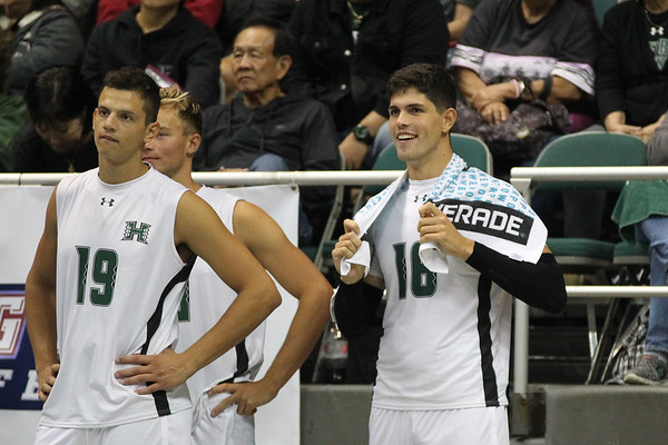 Hawaii's Rado Parapunov (19) and Filip Humler (16) watch the play on the court in an opening night match against Charleston at the Stan Sheriff Center in Honolulu, Hawaii on January 3, 2020. Humler, a 6-7 sophomore outside hitter from Czech Republic, had 2 kills on 2 attempts for a perfect 1.000 average. He also had 2 service aces, 2 block assists, and 5 digs.