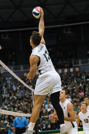 Hawaii outside hitter Colton Cowell (17) hits on the left pin in an opening night match against Charleston at the Stan Sheriff Center in Honolulu, Hawaii on January 3, 2020. Cowell led the team with 10 kills.