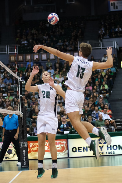 Hawaii middle Max Rosenfeld (13) winds up to hit a quick set from setter Jackson Van Eekeren (20) in the third game of an opening night match against Charleston at the Stan Sheriff Center in Honolulu, Hawaii on January 3, 2020. Rosenfeld did not register a kill but did add an ace and a block assist.